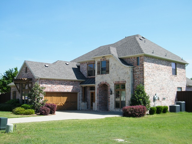 A brick suburban home, representing buying a property in Virginia.